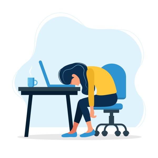 Persoon met hoofd op laptop heeft frustratie
